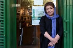 Lili Golestan poses in front of Golestan Gallery in Tehran in an undated photo.