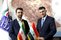 Iran's ICT Minister Mohammad Javad Azari Jahromi (l) and his Iraqi counterpart Naim al-Rubaye   pose for a photo in an undated picture
