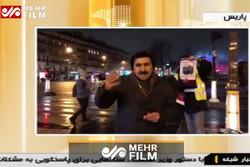 عکس سردار سلیمانی در دست معترض پاریسی!