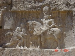 A bas-relief carving at Naqsh-e Rostam depicts the triumph of Shapur I over the Roman emperors Valerian and Philip the Arab.