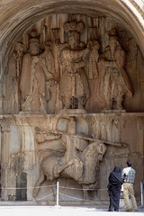 A couple visit Sassanid-era bas-relief carvings at Taq-e Bostan, Kermanshah province.