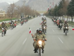 Armed forces stage motorcycle parade on anniv. of Islamic Revolution