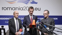From left, French Foreign Minister Jean-Yves Le Drian, UK Foreign Secretary Jeremy Hunt, and German Foreign Minister Heiko Maas launch the long-awaited special vehicle for Iran trade in Bucharest, Romania, on Jan. 31. (Daniel Mihailescu/AFP/Getty Images)