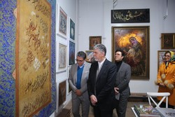 Minister of Culture and Islamic Guidance Seyyed Abbas Salehi (C) and his colleagues visit the Charsu-ye Honar exhibition at Tehran's Qasr Garden Museum on February 8, 2019.