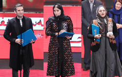 "actors Hutan Shakiba (L) and Elnaz Shakerdoost and director Narges Abyar after accepting their awards for ""The Night When the Moon Was Full"" during the 37th Fajr Film Festival at Tehran's Milad Tower"