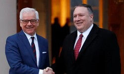 Poland's foreign minister, Jacek Czaputowicz, left, greets U.S. Secretary of State, Mike Pompeo, in Warsaw. Photograph: Kacper Pempel/Reuters