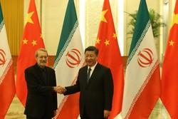 Chinese President Xi Jinping and Iranian Parliament speaker Ali Larijani