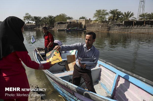 Distribution of books among villagers in Khuzestan