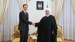 Rouhani meets Assad, says Iran ready to help rebuild Syria
