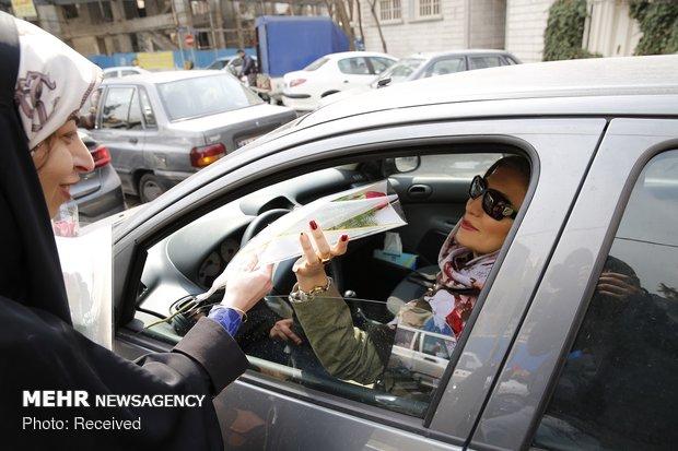 Donating flower to women on birthday anniversary of Hazrat Fatemeh (SA)