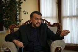 'No link between Zarif's resignation and Assad's trip to Tehran'