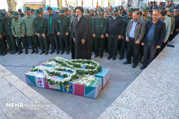 Two anonymous martyrs laid to rest in Payame Noor Uni.