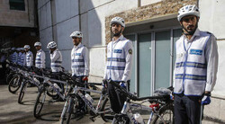 Police on bikes in central Tehran to promote bike-riding