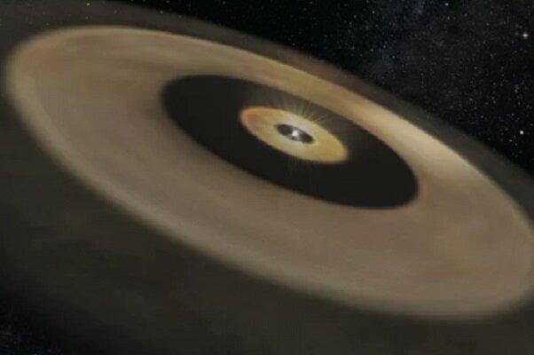 یک منظومه شمسی در حال شکل گیری کشف شد