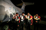 Freed Iranian border guards return home