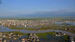 This photo by Fars news agency shows Aqqala in Golestan province inundated by flood waters.