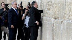 Israeli PM Benjamin Netanyahu  stands by as US Secretary of State Mike Pompeo visits the Buraq Wall