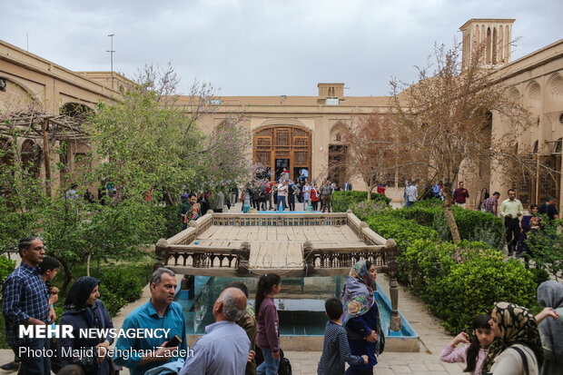 Travelers visit historical monuments in Nowruz