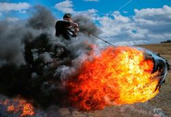 رسم آتش زدن لاستیک در رومانی