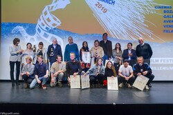 Winners and jury members pose during the closing ceremony of the Millenium International Documentary Film Festival in Brussels, Belgium, on March 30, 2019. (Millenium festival)