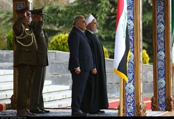 Iraqi prime minister is officially welcomed by President Hassan Rouhani at Saadabad Palace