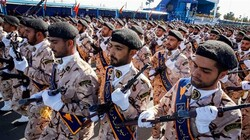 Members of Iran's Islamic Revolution Guards Corps (IRGC) march during the annual military parade marking the anniversary of the outbreak of the Iraqi-imposed war, in Tehran on September 22, 2018. (Photo by AFP)