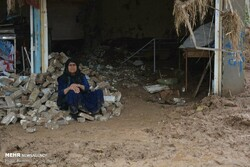 A woman sits in the ruins of her house in Poldokhtar on April 7, 2019 after a flood hit the town in Lorestan Province last week. (Mehr/Habib Bayat)