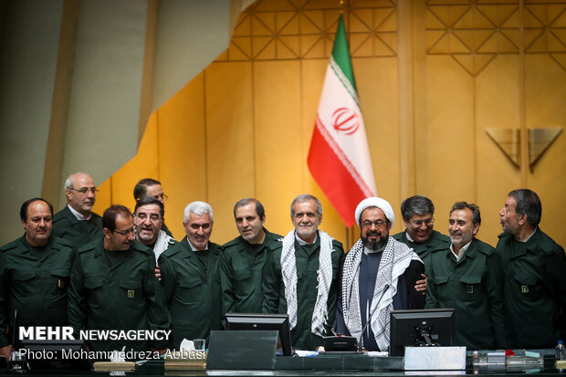 MPs dressed in IRGC uniform in open session