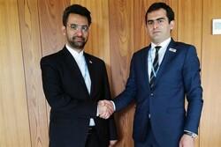 Iran's ICT Minister Mohammad Javad Azari Jahromi (l) shakes hand with his Armenian counterpart Hakob Arshakyan