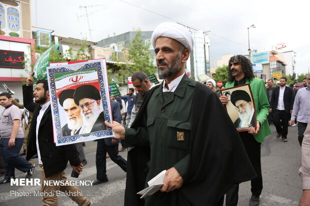 People in Qom march to protest at US' IRGC blacklisting