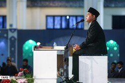 Salman Amrillah from Indonesia recites during the closing ceremony of the 36th International Quran Competition at Tehran's Imam Khomeini Mosalla on April 14, 2019.