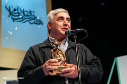 Filmmaker Ebrahim Hatamikia speaks after being honored as the Islamic Revolution Artist of the Year at Sureh Hall in Tehran on April 15, 2019. (Mehr/Hamid Vakili)
