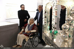 Monir Farmanfarmaian sitting in a wheelchair visits a permanent exhibition of her artworks that opened at the Negarestan Garden Museum of the University of Tehran on December 15, 2017. (Honaronline/Mo