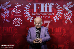 Animator Ali-Akbar Sadeqi holds a Silver Simorgh after being honored for his lifetime achievements during the 37th Fajr International Film Festival at Tehran's Charsu Cineplex on April 22, 2019. (Mehr