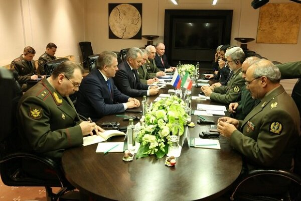 Iran, Russia vow to boost defense coop.