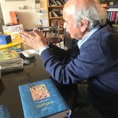 Persian literature scholar Mohammadreza Shafiei Kadkani is seen with a copy of Persian poet and mystic Farid ad-Din Attar's Tadkerat al-Awlia.