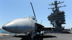 A Boeing FA18 Superhornet on the flight deck of the USS Abraham Lincoln in July 2011. (Photo by AP)
