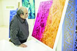 A man visits an art exhibit during the 26th International Holy Quran Exhibition in Tehran on May 22, 2018. (YJC/Arash Mirsepasi)