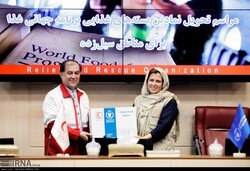 From right to left: Ms. Negar Gerami, WFP Representative in Iran and Mr. Morteza Salimi Head of Relief and Rescue Organization IRCS