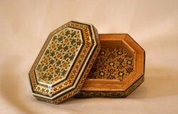 Khatam is an ancient Persian technique of inlaying; a version of marquetry where art forms are made by decorating the surface of wooden articles with delicate pieces of wood, bone and metal precisely-cut intricate geometric patterns.