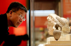 "A visitor tours ""The Splendor of Asia: An Exhibition of Asian Civilizations"" at the National Museum of China in Beijing, May 13, 2019."
