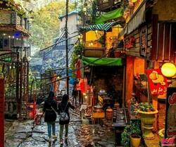 People walk through the atmospheric Darband village in northern Tehran.