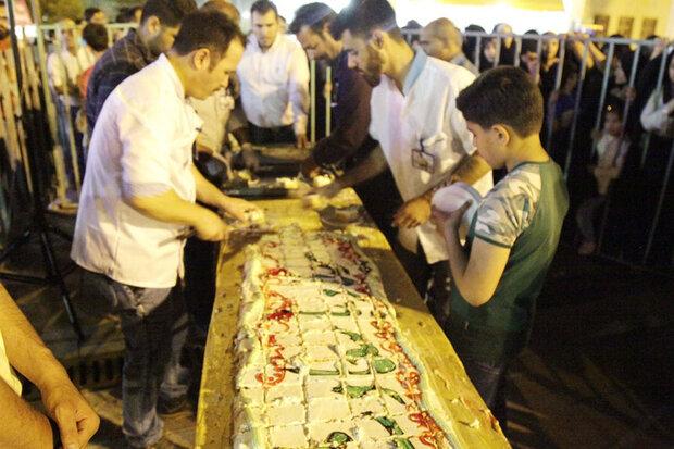 Hz. İmam Hasan (as) için 100 metre uzunluğunda pasta