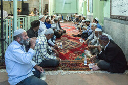 Sunni community break fasting (Iftar) in Aqqala