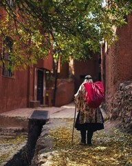 A native of Abyaneh walks in the historical mountainous village, which is located in Isfahan province, central Iran.