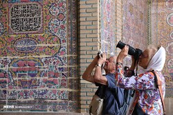 International travelers take photos of the 19th-century Nasir al-Molk Mosque, a tourist destination in Shiraz, southern Iran.
