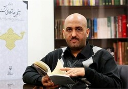 Iranian Poetry and Fiction Foundation director Mehdi Qezeli.