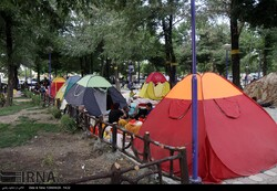 Domestic travelers set up their tents in visits to Mazandaran province, northern Iran.