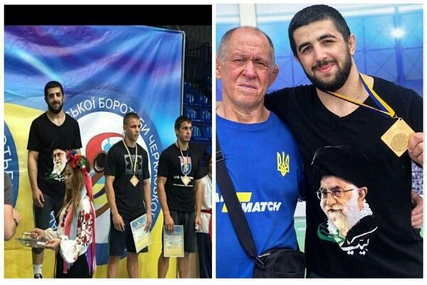 Ukrainian wrestler stands on champ's podium with singlet drawn with image of Islamic Revolution Leader