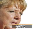 Merkel, Berlin'deki tören sırasında titredi